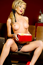 Sexy diva Angela Sommers flashing her tits in the old movie theatre from Penthouse