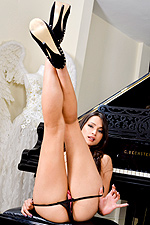 Chelsea French pleasuring her shaved pussy by the piano from Twisty's