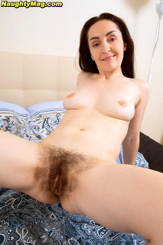 di devi spreads her hairy snatch wide open