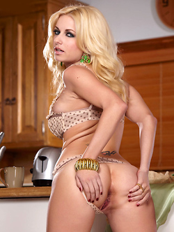 Danielle Trixie strips in the kitchen after her morning coffee