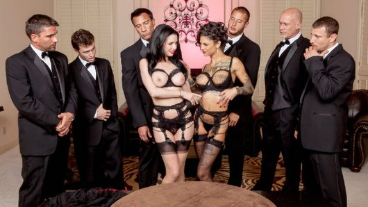 Veronica Avluv and her husband have arranged to enjoy her ultimate fantasy tonight: five well-hung dudes are booked to show up at her mansion and help bang the sweet fuck out of all her holes. She's brought along her slutty little assistant Bonnie Rotten, to help her push beyond the limits of what you thought possible, until they squirt on all the furniture, spraying hot cum over and over. Get ready for an epic hour-long fuckfest, with six dicks laying down Double Vag, Triple Penetration, double-sucking, and more filthy DP's than you can shake a dick at!