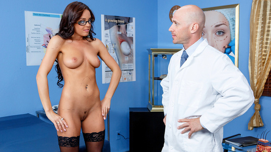 When Rahyndee walked into Dr. Johnny Sins' office, she wanted to get all kinds of work done, from facelifts to nips and tucks. But when she stripped down to some sexy black lace lingerie and thigh-high stockings for her consultation, Johnny knew she was way too hot to change! To convince her she was hot as hell just the way she is, first he ate out her wet pussy, and then she was so damn horny that she had to start sucking his big hard cock! He fucked her all over his office, and then gave her a massive cumshot all over her glasses!