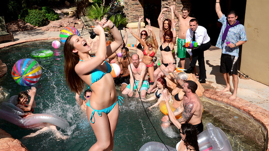 Dani Daniels knows that her time is limited, so she's determined to have the most fun she can before she gets carted off to the slammer. And when you're a big shot like the Whore of Wall Street, that means one thing... an orgy! Dani invites all of her hottest friends over to her place for a pool party, and wastes no time getting down to business. Dani and Monique Alexander strip off their skimpy little bikinis and start sucking on every hard dick they can find. The two sexy sluts take turns fucking and sucking Xander, Keiran, and Mick's big cocks one by one and two at a time, cumming over and over as Dani takes all the pleasure she can out of her last moments of freedom.