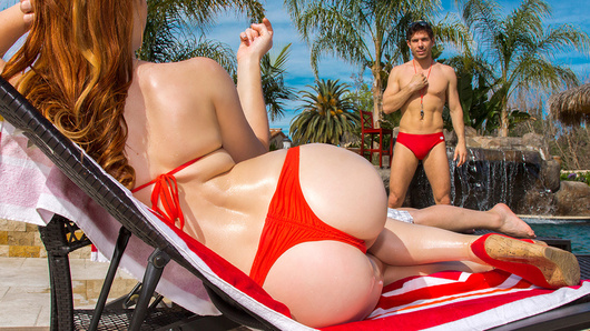 Dani Jensen is lying out by the pool, trying to catch some sun, when she asks her deadbeat husband to rub some oil on her. He refuses, and turns over to have a nap. Luckily for her, lifeguard Mick Blue is on duty and ready to service her in any way possible. He rubs the oil on her tight booty, and slowly works his way down until he's rubbing her wet pussy. Eventually, Mick's massage makes her so horny that she takes him back to the house to get it on! She passionately sucks his dick, and strokes it with her sexy feet until it's hard as a rock. Dani spreads her perky round ass cheeks, takes Mick's thick cock in her tight booty all the way to the hilt, and then begs for his jizz as he showers her with a big facial!