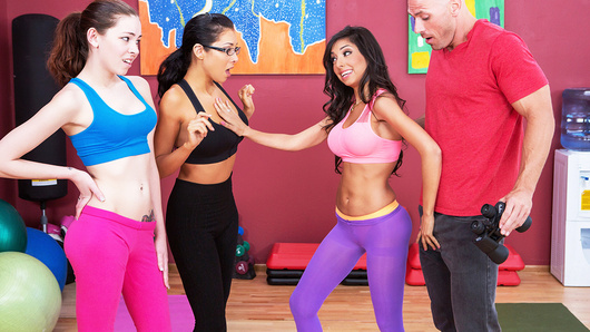 Trinity St Clair is a slutty yoga teacher who's busy teaching her friends some basic moves, when she spots local perv Johnny Sins eyeing them through the window. The other ladies are creeped out and quickly make an exit, but Trinity, being just as much of a horny perv as Johnny himself, decides she wants to get some! She drops Johnny's pants and starts blowing his fat cock, sucking, stroking, and even fucking it with her perky tits. Johnny pounds her tight teen pussy until she cums hard, and then he sticks his big dick balls deep in her tight little asshole! Johnny fucks her ass hard and then busts a big nut all over her pretty face, because when it comes to perverts, it takes one to know one!