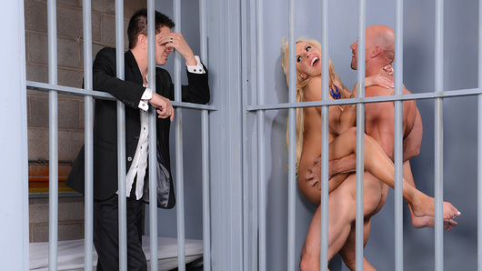 When Nina Elle's husband got arrested for solicitation, the police called her to come bail him out. This wasn't the first time her sleazebag hubby had gotten caught with his dick in some whore, so Nina decided to give him a little taste of his own medicine. Seeing Johnny Sins in the cell across from her husband, Nina asked the guard on duty to lock her in with him, so she her husband could see her suck and fuck Johnny's big dick. She gave him a nice sloppy blowjob and then titty-fucked that convict cock until her pussy was dripping wet. Johnny went balls deep in that tight pussy and then busted a fat nut all over Nina's face, all while her husband watched from across the way!
