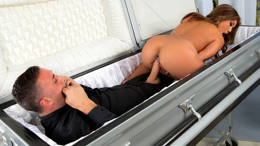 Keiran Lee is a funeral director, and while he was at work one day, his ex, busty Asian milf Akira Lane, decided to swing by and get a piece of that dick for old time's sake. While guests were filing in and finding their seats, Akira dropped to her knees to discreetly give Keiran a nice public blowjob. She sucked on his nuts, stroked his shaft, and then took that dick balls deep in her tight pussy. She rode that dick until she came and then took a big facial cumshot with a smile. That's one way to honor the departed!