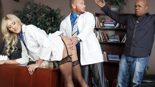 Hospital administrator Marco Ducati has received some complaints about one of his doctors, a busty blonde beauty named Audrey Show. Determined to show his clients that he's no slouch when it comes to disciplining his staff, he calls Dr. Show into his office for a little one-on-one. Peeling her short skirt off of her juicy round booty, Dr. Ducati gives Audrey a nice spanking and then fucks her pretty face. Stripping down to stockings, garters, and some sexy high heels, Audrey rides Marco's cock, her big fake tits bouncing as she cums all over that big dick!
