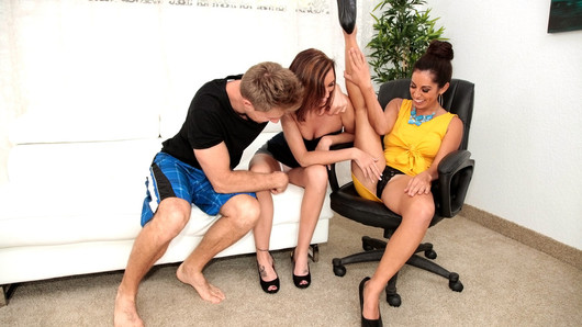 Levi met up with two hot MILF's on their lunch break. The fiery and wild Phoenix Rose, whom Levi had the pleasure to entertain in the past, brought a friend, the sultry and sexy Sofia Rivera. Both girls were all game for a little fun, and they left it all up to Levi. He quickly got back to the house where we found out that Sofia was into yoga and incredibly flexible. With Sofia's legs behind her head, Phoenix started eating her delicious shaved pussy. Levi soon jumped in and fucked both girls proper. The ladies were totally into each other and got a hard cock in the middle. As they explored each other and Levi, they were constantly working dick, as titties and booties bounced all over. Cum covered and satisfied, these MILFs were ready to finish their day in the office now...