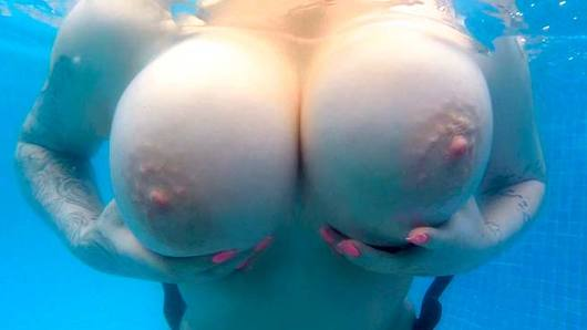 British bombshell Harmony Reigns visits Spain. Harmony has super huge tits, a fat pussy, and a big ass. This babe knows how to get down and dirty, it doesn't matter where; even if it means sucking dick at the bottom of the pool, Harmony is up for anything! She's my kind of gal. Come watch her get titty-fucked and bent over pool-side!