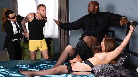 Dani Daniels married her husband for two reasons, money and kinky sex. She loves being handcuffed to the bed almost as much as she loves her husband's money. So when the feds busted her beloved one for insider trading, she gets righteously pissed off. Agent Prince is more than happy to help the handcuffed housewife teach her lying husband a lesson. He fingers and licks her pretty pussy while her husband looks on helplessly. Dani's husband is about to watch his wife get fucked by the long dick of the law!