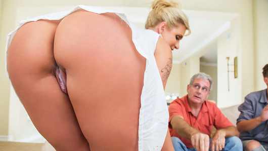 Ryan Conner wants to watch the big game with her husband and her stepsons, but there's no room for her on the couch, so she takes a seat on her stepson Bill's lap. With his stepmom's perfect ass grazing against his dick, Bill instantly gets hard. Ryan is shocked at how big and thick her stepson's cock feels, and decides to tease him a bit by grinding her ass against him. She gets so turned on, she sneakily frees his cock from his pants and fucks him right beside her husband!