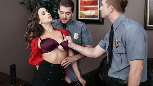 Ashley Adams doesn't take kindly to the security guards in her office building wanting to stop and search her on her way to work. She shows them no respect, taunting and even slapping them. So when security guards Bill Bailey and Xander Corvus show up in her office at the end of the day, she is pleasantly surprised when they man up and give her the fucking she so richly deserves.