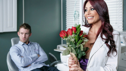 Danny D is looking forward to his dentist appointment so much that he's even bought flowers for his sexy doctor, Monique Alexander. He enjoys the way she shamelessly flirts with him and how much cleavage she shows during their routine check-up together. But when he sees how Monique is with another patient, Danny thinks he's wasting his time trying to score with her. Will Ms. Alexander be able to appease Danny D and give him the special treatment he's seeking?