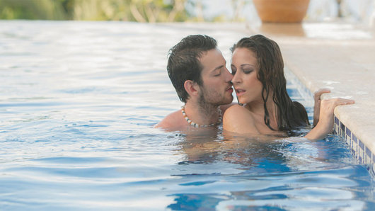 Relaxing in the resort's infinity pool, Martina Gold felt every ounce of tension slip away into the distance. When Joel slipped up behind her to surprise her with a kiss on the neck, and his pawing hands all over, her body responded instantly and she felt a hot lust inflame her crotch. Martina got up on the side of the pool and pulled her bikini bottom aside so Joel could give her pussy a slow lick right up the middle, and tease her with tongue right on her clit. And when Martina was horny for his fat cock, she slipped back in the water so Joel could dive inside her from behind. Craving something more, Martina got on the deck and took a breath while Joel pressed the tip of his dick against her tight asshole, before taking him balls deep for an al fresco anal fuck in the afternoon sun!