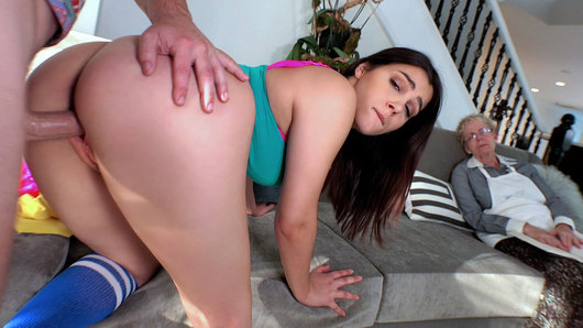 Valentina Nappi is totally turned on by danger, and what's more dangerous than having her tight pussy plowed while her grandma naps a few feet away. Hopefully this busty Italian can keep her moans to a minimum so grams doesn't wake up and catch them.