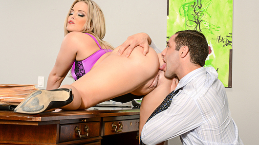 Alexis Texas finds her employee jacking off to pictures of her. She decides that the best way to stop him from being distracted on the job, is to give him what he wants. So she has him fuck her on his desk.