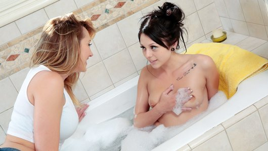 Brett Rossi couldn't help noticing how much Megan Sage enjoyed playing with herself in the tub. Brett just had to have a taste of that tight teen pussy of hers! Sharing is caring, and nothing separates these two roommates from sharing their hot bodies with one another in this hot lesbian sex scene.