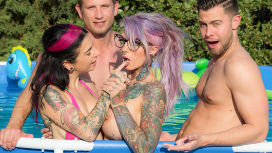 Meet Sydnee Vicious! She's a heavily inked, submissive, grunge-y punk rock chick with big fake bouncy tits, and is truly something special. Sydnee's never had two cocks at the same time either, and we captured it all on film! I played with her pussy and gave her a spanking in the pool, then introduced her to Bill Bailey's and Seth Gamble's dicks. When she began sucking them off, the boys found they could fuck her ear holes through the gauges! She's a bad girl - and Sydnee was so horny, she took both of them inside her vagina! Double vaginal penetration! Talk about making a splash.