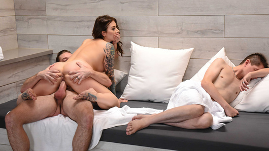 Ivy Lebelle and her husband are celebrating their anniversary with a trip to Vegas, but they can't agree on how to have a good time. He wants to hit the casinos, she wants to enjoy the hotel spa. Ivy finally drags her husband to the sauna and they both get so relaxed they doze off. Ivy wakes up to see a horny stranger has joined them, and he's not shy about showing her his hard cock. Ivy is freaked out and tries to wake up her man, but she isn't successful. Annoyed at her husband and feeling neglected, she decides to have a game of show-and-tell with the stranger. But how far will she go?