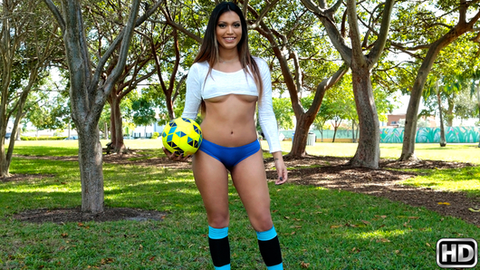 Nicole Ray went to the park in her sexy soccer gear to learn how to play. Bruno immediately noticed her sexy ass and went into full stealth mode. He crept behind a tree and watched while she stretched. When she began to kick the ball around, Bruno moved in closer and then into the line of fire. The ball hit his face and that's all he needed to make his move. He offered to teach Nicole how to play back at his place. She mulled over the suggestion for a few minutes and then agreed. Soon enough, Bruno had his dick in her mouth. He fucked her tight pussy all over his couch and then blasted her pretty face with a load of his jizz!