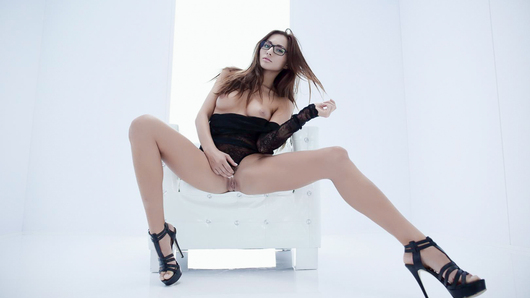 Hot dirty-minded Czech babe Michaela Isizzu is horny for some pussy-fingering and lesdom action. She ties her naughty little girlfriend Lucy Li down to a table and makes her watch as she furiously masturbates right next to her. (Video duration: 10 minutes)