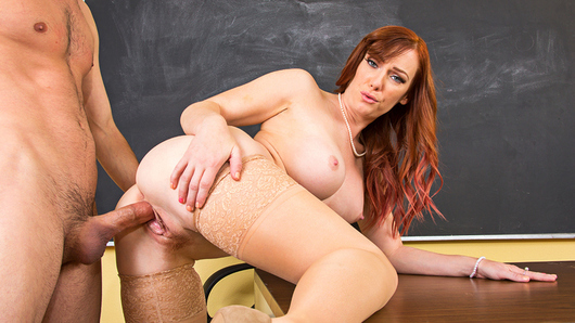 When college teacher Dani Jensen finds her student Tyler sulking alone in her classroom after class is out on a Friday, she feels like she needs to console him. She learns that his girlfriend recently broke up with him, and now he feels completely lost at sea in all aspects of his life. Ms. Jensen feels she needs to do her duty as his instructor and make him feel better by pulling out his dick and giving him a blowjob! Tyler's blown away, but he's fine with being blown by his teacher, and then some! Never did he think he'd be banging his college prof on her desk, but dreams can come true! And Tyler can cum in Ms. Jensen's face, too... so he does!