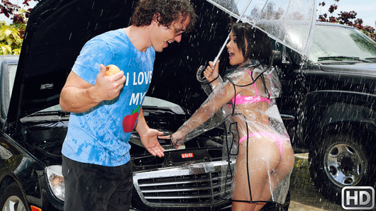 Car troubles are bad, but they're even worse when they occur in the middle of a rainstorm! This is what is happening to Holly Hendrix whose car just won't start, leaving her stranded in the pouring rain wearing only a transparent raincoat which barely covers her hot pink lingerie and boots. In her skimpy outfit, the hot brunette inspects the car engine, hoping to find the problem. Thankfully Robby Echo comes to her rescue and offers her a much-needed shelter from the storm! As soon as he invites her into his car, Holly pushes him inside and starts making out while reaching for his dick! Holly has a few ideas how to spend time, starting with sucking Robby's big cock! Robby then suggests they go back to his place to dry off from the rain. That's where he finds out just how wet the hot slut really is! And she just keeps on getting wetter and wetter as he fucks her tight dripping pussy!