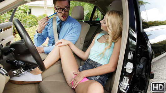 Petite teen Riley Star really sucks at driving. When her uptight instructor, Kyle Mason, tells her she isn't road-ready, Riley tries to bribe her way into passing her exam by masturbating over her pretty pink panties. Mr. Mason turns her down, but Riley is so determined to pass her driving test and hungry for dick she pulls his pants off and sucks his cock in broad daylight. Mr. Mason might not think Riley is capable behind the wheel, but he decides she can handle a face-fucking. Riley wants her license so bad she spreads her asscheeks and lets Mr. Mason bend her over the car for a high-speed fucking. She might not be able to drive a car, but she sure can ride a dick! Riley shows Mr. Mason all her moves, and when he's done making a grade-A mess of her, he gives her a pass on her exam. Watch out for Riley!
