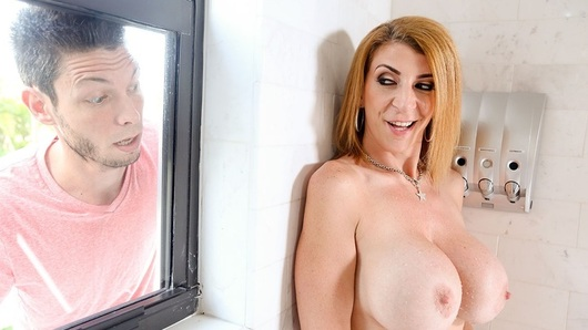 Sara Jay knows what's up. Her neighbor Tyler spies on her taking a shower every morning and night, drooling as she soaps up those big tits and her huge ass, and Sara knows it! But she doesn't say anything. Instead, the horny cougar plots to get what she wants, Tyler's big dick in her mouth! So after she masturbates in the shower for Tyler's creeping ass outside her bathroom window, Sara calls him up and asks him to help her flip a mattress. He's over in a jiffy, of course, but wait, he doesn't see a mattress! And Sara walks out in a bra and panties. Surprise! Time for Tyler to pay Sara what she's owed for all the free peep shows she's given him, a hot creampie in her wet, craving pussy!
