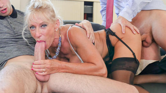 French blonde teacher Marina Beaulieu sucks off Rick Angel and her student Tony Garcia. This minx would do anything for a raise so she spreads her pussy and ass open to receive their big cocks. She gets pussy creampied and her mouth full of cum. (Video duration: 30 minutes)