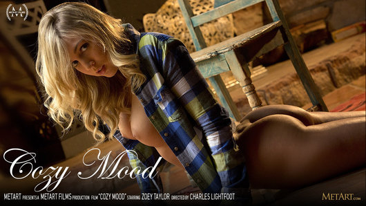 Wearing an open-front plaid shirt that exposes a sexy expanse of her ample boobs, and denim shorts cut so that her peachy ass cheeks are on full view, blonde babe Zoey Taylor looks casual, yet stunningly sexy. When the American beauty stops staring out of the window, she turns, smiles, and her gorgeous green eyes signify she's is a sensual mood. It's no surprise when she slides the shirt off her shoulders, and slowly slips the shorts down over her curvaceous rear, so she can jut it out at the camera, invitingly. When she sits down, her legs part and reveal her pussy is clean-shaven apart from a finely trimmed triangle of fuzz. Her hands repeatedly move up and down her deeply tanned body, caressing her breasts and teasing over her crotch, causing her arousal level to rise exponentially.