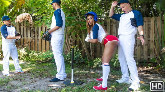 Batter up! Bootylicious ebony beauty Moriah Mills is all ready for some hardball in her t-shirt and tiny red shorts, but her boyfriend won't let her play with the big boys. Lucky for her, pinch hitter Sean Lawless is all too willing to help Moriah practice her swing... and fondle her round, sexy tits while she twerks against his crotch! Once they're left alone, Moriah sucks on Sean's juicy ballpark frank, then Sean gets deep into Moriah's dugout, worshipping her pussy, fucking her doggystyle, and rounding the rest of her bases. It's a grand-slammin', all-American good time! But when Moriah's boyfriend catches her covered in Sean's sticky man-goo, will she be called safe, or thrown out? Moriah's boyfriend learns the hard way that there's no crying in baseball! Wouldn't you want Moriah on your team?