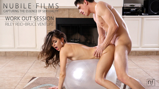 Super sensual Riley Reid is completing her daily yoga exercises when her man Bruce Venture joins her in the workout room. Things get hot and heavy right away as Bruce takes advantage of the exercise ball to turn Riley on until she can't wait to get naked and work out in a totally different way. She starts things off with a blowjob that begins with slow strokes of her mouth. As Riley gets her man's cock dripping wet with her spit and his precum, she gets even more excited and enthusiastic about licking her beau's rock hard dick and ball sack. Rising to her feet, Riley takes the opportunity to give her man a lapdance that gets him harder than ever. When she tires of teasing him, she spreads her pussy lips and sinks down slowly onto Bruce's massive erection. The exercise ball that Bruce is leaning on offers incredible bounce as Riley goes to town satisfying her lustful desires. Flipping Riley around, Bruce seats his woman back on his dick so that she can ride him cowgirl style to her heart's content. Her moans soon fill the room as she rocks her hips in a hard fast rhythm that gets them both hotter than ever. Next it is Riley's turn to lie back on the ball and let her man do the work. He starts by burying his face in her hairy pussy, licking her soft folds and then sliding two fingers deep into her tight sheath to test her wetness. Finding her dripping with passion, Bruce pushes his hard cock deep into her welcoming heat and starts thrusting his hips with slow deep pushes. Flipping onto her belly, Riley thrusts her ass up into the air and spreads her legs so that she is nice and exposed for a second round of pussy eating and a doggy style fuck. The ball beneath her slim body rubs her tits and teases her hard nipples as her man delivers a proper pussy pounding, and the combined friction quickly send her through the roof with pleasure. Finally abandoning the exercise ball to finish each other off, Bruce lies down on the floor and Riley climbs aboard for one last ride. Her pleasure comes quickly, giving her the throbbing climax that she craves. Wanting to give her man the same pleasure, she uses her hands and eager mouth to bring him to a big orgasm that jets his cum into her waiting mouth so that she can swallow every last drop.