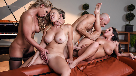 Johnny thinks he has it made: a hot wife with big tits and two sexy side pieces, all of whom worship his giant cock. Little does he realize the ladies in his complicated love life have learned about one another, and they are not pleased. His wife Angela White has invited Phoenix Marie and Kagney Linn Karter over for dinner to confront Johnny and show him who really runs the show. (Video duration: 40 min)