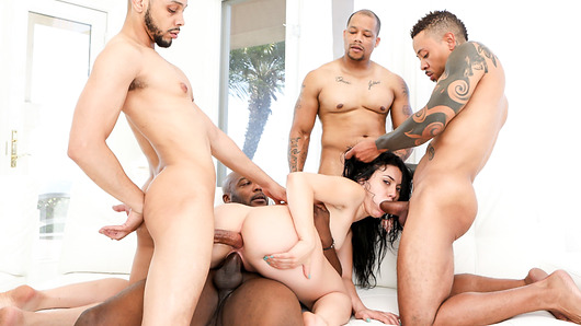 Mandy Muse has always been a sexual freak and we get an in depth interview with her as she tells the viewer of her innermost desires and dreams for her future. Which mostly encompass fucking as many black men as possible. After a breathtaking tease she gets down and nasty with her four guests who proceed to try to maintain her sexual energy as they attack her many holes with erect cocks hard as rocks. She slurps down all four cocks at once and proceeds to offer up all her holes as they fuck her little pussy mercilessly and impale her winking pink sphincter with massive man root in a non stop train of lust. And just when you think you cannot take anymore pleasure she is cascaded in a cloudburst of salty juicy sperm. Bon Appetit.
