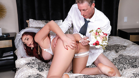 Not-so-blushing bride Skyla Novea is all dressed for her big day, but she's having some cold feet. When her father-in-law-to-be Ryan McLane comes in to see whether she's ready to walk down the aisle, Skyla confesses that she's worried she won't be faithful because her fiance can't fuck her the way she wants. Ryan recognizes just what Skyla needs, and he gives it to her! He takes control of the slutty submissive, holding her by the throat as he fingers her pussy. Skyla loves when Ryan sucks her huge tits and bends her over to fuck her pussy and then her ass, and she fingers her pussy as Ryan slides the secret dildo hidden in her bouquet into her tight asshole! Skyla's future father-in-law covers her face with his jizz, but it's not going to be a white wedding!