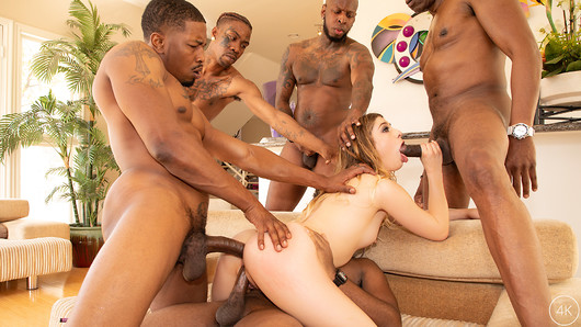 Kristen Scott gets more BBC than she can handle as she's gangbanged by 5 black studs for her FIRST GANGBANG! Kristen is looking sexy as ever in her Pink latex skirt, black polka dot top and pink high heels as she shows off her body for the camera. She's not wearing any panties so when she squats down we get an amazing view of her tight young pussy. Kristen rubs her pussy then pulls up her top to expose her perfect perky tits then crawls over to the living room to wait for her studs to arrive. The guys show up and immediately start running their hands all over Kristen's body, fingering her tight holes and pinching her nipples to get her all turned on. She drops to her knees as the crew pulls out their giant BBC's and gets right to sucking and stroking those massive cocks. Barely coming up for air, Kristen moves from one cock to the other with devotion to please each dick equally. The guys help her out of her clothes then Kristen puts her ass up in the air to tell the guys she's ready to be fucked. Kristen takes all those cocks in every one of her horny holes, then once she's warmed up they increase the intensity and pound her holes at the same time to bring Kristen to DP heaven! She takes those cock like the good slut she in then gets back on her knees as all the guys unload on her pretty face, leaving her covered in cum! (93 photos, 37 min of video)