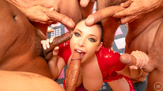 Angela White takes on 13 studs in her biggest blowbang ever! Dressed in a sexy red latex dress Angela welcomes her cocksmen to the house as they enter one by one. Once the last one comes in, she shuts the door and the guys swarm her and pull out her massive tits while others pull her dress up and take turns licking her sweet pussy. Angela has her studs line up along the staircase with their cocks out so she can make her way upstairs, sucking every cock along the way. The guys service her pussy once she's done with their big dicks as she makes her way up the stairs gagging and slobbering all over each and every cock. When she makes it to the top Angela is surrounded by cocks in every direction and gets to pleasing each and every one with her hands, tits and mouth. They move back downstairs where Angela strips out of her dress leaving her with only her thigh high boots on as she gets on her knees to suck all the dicks. At one point they try to see how many cocks they can fit in her mouth at the same time so they jam as many as they can down her horny throat before letting her up for some air. Once the guys are ready to explode Angela grabs a wine glass to collect all of their splooge in before drinking every last drop. You've gotta check out Angela's biggest ganging ever with 13 guys and 16 loads (3 guys came twice!)! (72 photos, 47 min of video)