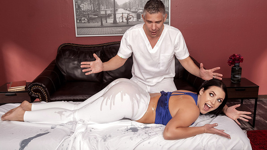 Angela White's husband has booked her a post-workout massage, but Angela really has only one thing on her mind: anal sex. Unable to focus on her workout because she's so horny, Angela sees masseur Mick Blue as the ideal candidate to satisfy her needs, but she quickly realizes that she must point him in the right direction, which she manages thanks to a sneaky sleight of hand with Mick's bottle of oil. Once Angela is thoroughly soaked in exactly the right spot, she encourages Mick to attend to her properly, all while managing to keep her husband at bay. (Video duration: 35 min)