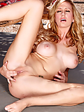Brett Rossi fingering her sweet pussy outdoors on the patio