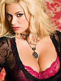 Shyla Stylez strips off her sexy lingerie and stockings