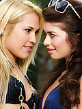 Kimberly Kiss kissing and licking Ashlyn Rae in the Polynesian paradise
