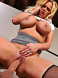Shyla Stylez uses her massive tits to fuck him in the office