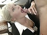 This clip from Secretaries by Combat Zone features Kathy Anderson in her office suit on her knees with a big hard cock in her mouth licking and sucking on it like a starving woman getting all she can.
