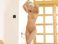 Join blonde babe Lola Myluv (a.k.a. Dido Angel) as she fondles her busty tits and uses her magic fingers to drive her bald wet pussy wild.