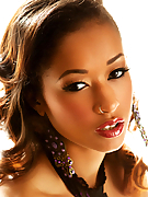 Skin Diamond masturbating in front of the window wearing high heels