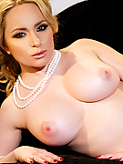 Aiden Starr classy lady unveils her juicy tits and pink pussy on the divan