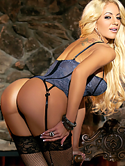 Nicolette Shea seduces you in a corset and fishnet stockings