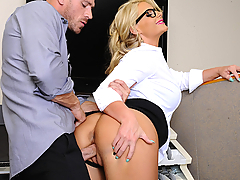 Phoenix Marie is just too nice of a boss and lets her employee push her around. Phoenix interrupts him while he is trying to solve his puzzle cube, because she wants to make sure he's going to get the reports on time to her tomorrow. Johny tells her that hasn't had time to do it and will get to it to her when he can. Johnny wonders how she expects him to work when there's no type of motivation in the office. Phoenix lets him know that he may get fired, but she won't fire him because she knows he'll find the motivation to get the reports done. That motivation is Phoenix's huge ass! He turns her around, bends her over the cubicle and has her hike up her dress. She has her innocent face on but, I'm sure she knows and wants what is going to happen next.